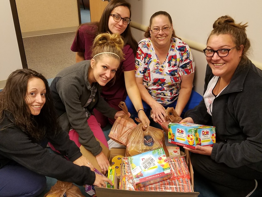 Ross Medical in Morgantown Joins Scott's Run to Fill Backpacks With Food for Local Children